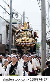 "Karatsu, Japan - may 5, 2019 : people in traditional costumes drawning massive float through the street during new imperial era ""reiwa"" celebration parade"