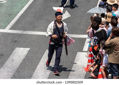 "Karatsu, Japan - may 5, 2019 : people in traditional costumes parade through the street during a parade to celebrate new imperial era ""reiwa"""