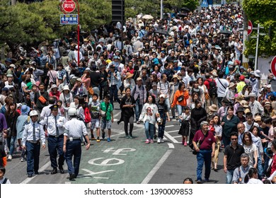 "Karatsu, Japan - may 5, 2019 : crowd of people walking through the street after the parade to celebrate new imperial era ""reiwa"""