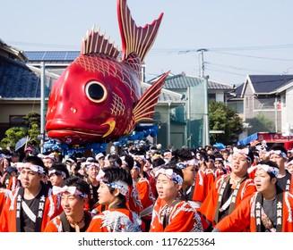 Karatsu, Japan - November 3, 2016: Young men in colorful traditional clothes at Karatsu Kunchi festival
