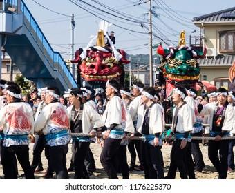 Karatsu, Japan - November 3, 2016: Otabisho Shinko ceremony is the main event of Karatsu Kunchi festival; massive colorful floats are being pulled through the sand of Nishinohama beach.