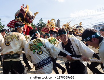 Karatsu, Japan - November 3, 2016: Otabisho Shinko ceremony is the main event of Karatsu Kunchi festival; massive colorful floats are being pulled through the sand of Nishinohama beach.