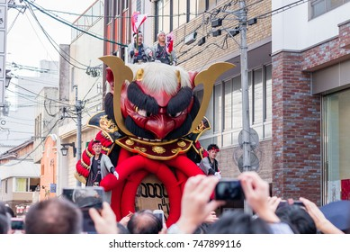 KARATSU, JAPAN. NOVEMBER 3 2017. the massive float representing the famous samurai Takeda Shingen's helmet is drawn through the streets during annual Karatsu Kunchi traditional festival.