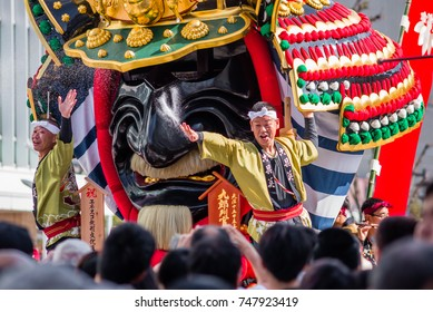 KARATSU, JAPAN. NOVEMBER 3 2017. the massive float representing a the famous samurai Takeda Shingen's helmet is drawn through the streets during annual Karatsu Kunchi traditional festival.