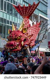 KARATSU, JAPAN. NOVEMBER 3 2017. the massive float representing a flying dragon is drawn through the streets during annual Karatsu Kunchi traditional festival.