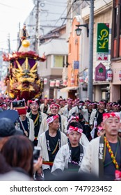 KARATSU, JAPAN. NOVEMBER 3 2017. people drawn massive float representing the Boat of seven treasures through the streets during annual Karatsu Kunchi traditional festival.