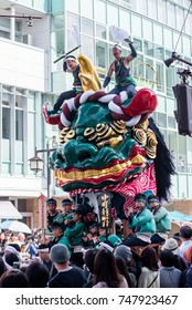KARATSU, JAPAN. NOVEMBER 3 2017. the massive float representing a green lion is drawn through the streets during annual Karatsu Kunchi traditional festival.
