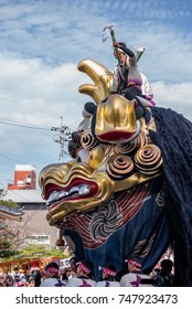 KARATSU, JAPAN. NOVEMBER 3 2017. the massive float representing a golden lion is drawn through the streets during annual Karatsu Kunchi traditional festival.