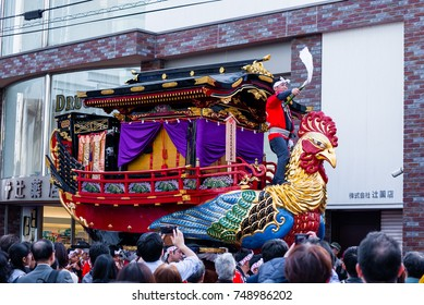 KARATSU, JAPAN. NOVEMBER 3 2017. the massive float representing a phoenix-shaped ship is drawn through the streets during annual Karatsu Kunchi traditional festival.