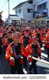 "Karatsu, Japan - november 3, 2018 : children in traditional costumes drawning float through the street during Karatsu city ""kunchi"" annual parade"