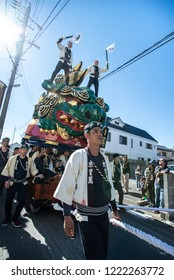 "Karatsu, Japan - november 3, 2018 : people in traditional costumes drawning lion on a orb float through the street during ""kunchi"" Karatsu city annual parade"