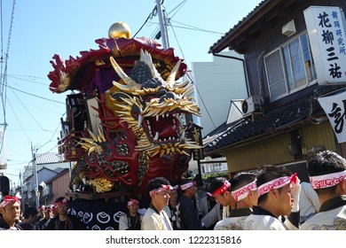 "Karatsu, Japan - november 3, 2018 : people in traditional costumes drawning ""The Boat of seven treasures"" float through the street during Karatsu city annual ""kunchi"" parade"
