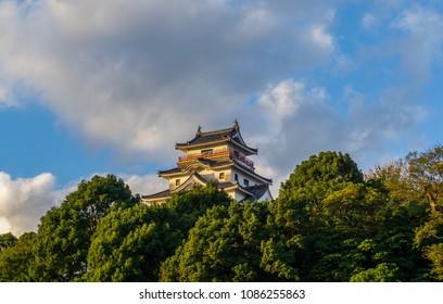Karatsu japanese Castle (Karatsu-jo) Located on hill and blue sky with clouds in evening, Karatsu, Saga, Kyushu, Japan