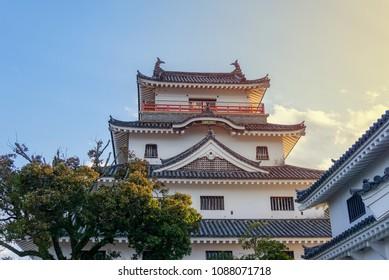 Karatsu japanese Castle (Karatsu-jo) Located on hill and sunset sky with clouds in evening, Karatsu, Saga, Kyushu, Japan