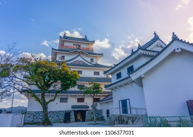 Karatsu japanese Castle (Karatsu-jo) Located on hill and sunset sky with clouds in evening, Karatsu, Saga, Kyushu, Japan