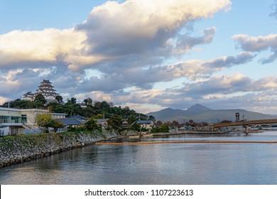 Karatsu japanese Castle (Karatsu-jo) Located on hill and blue sky with clouds at the side of matsuura river in evening, Karatsu, Saga, Kyushu, Japan