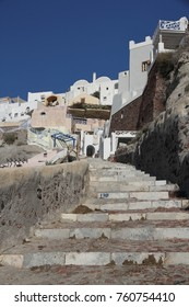 The Karavolades steps used by tourists and donkeys connecting the old port to the village of Fira, Santorini Island, Greece.