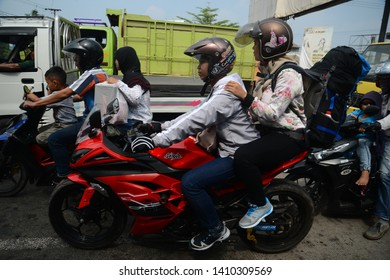Karawang, West Java, Indonesia,  June 10st, 2018. Mudik or Pulang Kampung is Indonesian moslems tradition to come to their hometown from Capital or big city, to celebrate Eid Fitri.