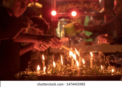 Karbala, Iraq - September 16, 2018: Procession/Mourning Event of Ashura with Miniature Mausoleums, a shia Muslim ritual that reenacts the death of Hussein in a brutal massacre on the plains of Karbala
