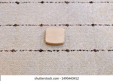 Karbala stone or turbah clay on the carpet used by Shia Islam for prayer.