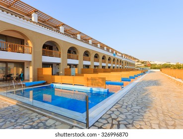 KARDAMENA, KOS/GREECE - July 29, 2015: Private pools with salty water in front of each room. Mitsis Blue Domes resort.