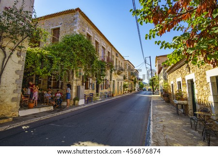 KARDAMYLI - GREECE JULY 22 2016: Architectural buildings at the main street of Kardamyli town. It is a coastal town 35 kilometers southeast of Kalamata. Messenia - Greece.
