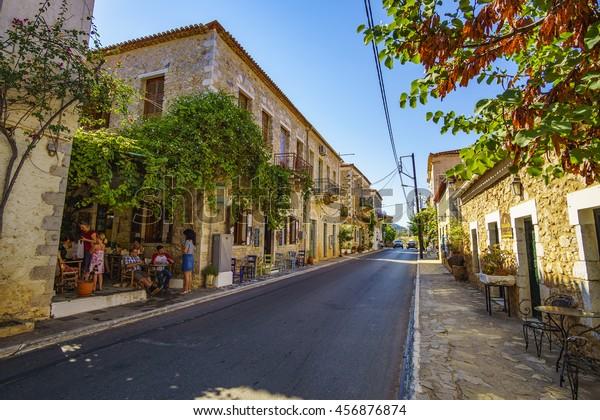 KARDAMYLI - GREECE JULY 22 2016: Architectural buildings at the main street of Kardamyli town. It is a coastal town 35 kilometers southeast of Kalamata. Messenia - Greece.