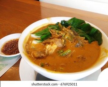 Kare kare, filipino oxtail stew, philippine cuisine in a restaurant setting