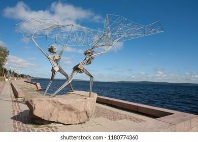 "Karelia, Petrozavodsk, July 2018: sculpture ""Fishers"" on the Onega lake coast."