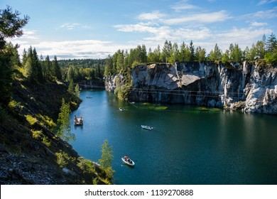 Karelia, Russia - August 18, 2015: Marble quarry in Ruskeala Mountain Park. The Ruskeala marble deposit was discovered in 1765.Now these deep quarries and adits serve as a popular tourist attraction.