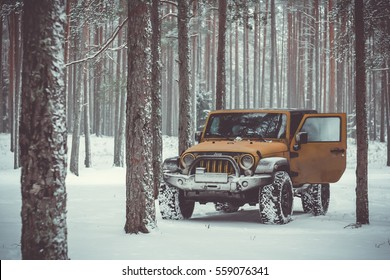 Karelian isthmus, Leningrad region, Russia - January 15, 2017. Jeep Wrangler unlimited on a forest road, the Wrangler is a compact SUV produced by Chrysler