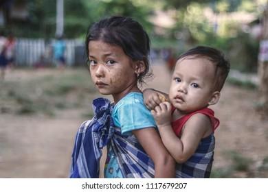 Karen state,Myanmar - October 19: young women karen  with bother at Ituta refugee camp