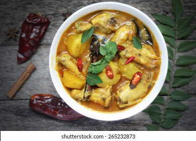Kari Ayam - Malaysian Traditional cuisine. Spicy chicken curry with coconut milk garnished with curry and mint leaves