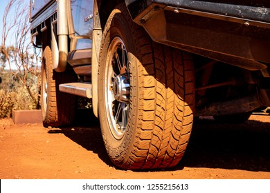 KARIJINI, WESTERN AUSTRALIA - JULY 10, 2018: The detail of a Yokohama Geolandar off-road tyre on a 4x4 car. It is dirty because of a red soil and dust.