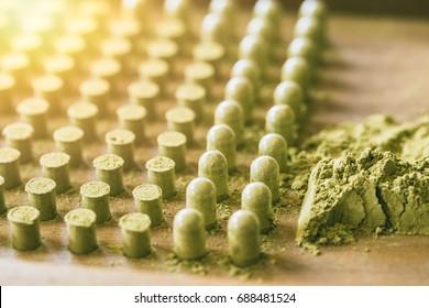 Kariyat Organic dried green herbal drug an alternative medicine with capsule packing tool.