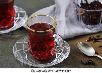 karkade tea -  red tea in Turkish cups on a grey background