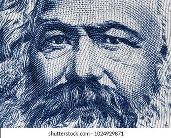 Karl Marx portrait on East German 100 mark (1975) banknote closeup macro, famous philosopher, economist, political theorist, sociologist and revolutionary socialist.
