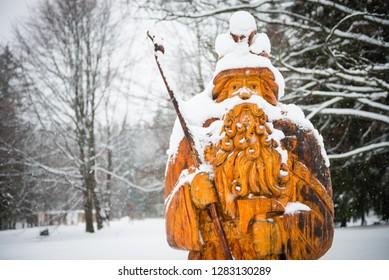 KARLOVA STUDANKA, CZECH REPUBLIC – JAN 2, 2019: Statue of Praded - mythical figure, patron and guard of Jeseniky Mountains in Czech Republic - one of symbols of Czech folklore and legends.