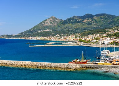 Karlovasi town, Samos island, Greece - May 24, 2017: the harbour with boats in Karlovasi town and mountains in the background