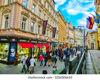Karlovy Vary, Cszech Republic - January 01, 2018: The people going at center with facades of old houses at Karlovy Vary, Czech republic on January 01, 2018