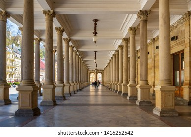Karlovy Vary, Czech Republic - April 2019: Diminishing perspective interior view of hallway along with stone columns with Renaissance style decoration at Mill Colonnade.