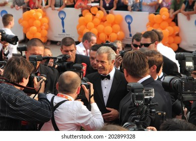 KARLOVY VARY, CZECH REPUBLIC  JULY 4, 2014: Mel Gibson arrived to Karlovy Vary International Film Festival to pick up a Crystal Globe for his contribution to cinema