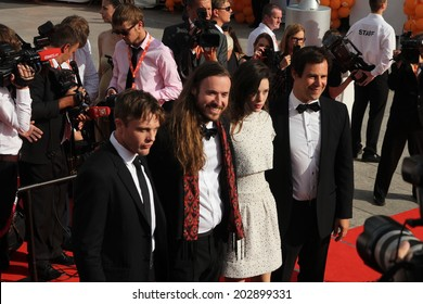 """KARLOVY VARY, CZECH REPUBLIC  JULY 4, 2014: Actor Michael Pitt, director Mike Cahill, actress Astrid Berg�¨s-Frisbey, producer Alex Orlovsky (L-R) to present the film """"I Origins"""""""
