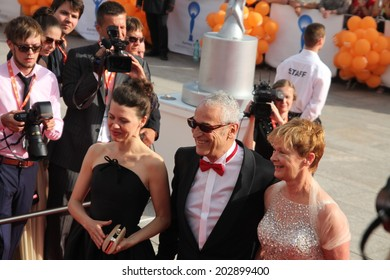 KARLOVY VARY, CZECH REPUBLIC  JULY 4, 2014: Members of the Grand Jury Mira Fornay, Luis Minarro and his wife (L-R) arrived to at the International Film Festival, Karlovy Vary