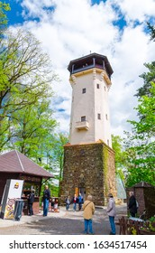 Karlovy Vary, Czech Republic, May 9, 2019: Diana Observation Tower (Rozhledna Diana) in Slavkov Forest with green trees near Karlovy Vary (Carlsbad) town, West Bohemia, Czech Republic