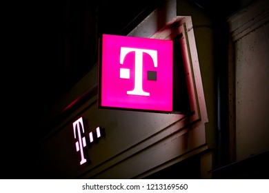 KARLOVY VARY, CZECH REPUBLIC – OKTOBER 02, 2018: Neon sign at a Telecom Shop in downtown Karlovy Vary in the Czech Republic at night