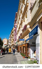 KARLOVY VARY, CZECH REPUBLIC – SEPTEMBER 30, 2018: Typical shopping street with expensive shops in the city center of Karlovy Vary in the Czech Republic