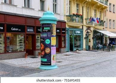 Karlovy Vary, Czechia - September 11, 2017: There is an advertising column on the sidewalk, where posters and advertisements are displayed, which is one of the ways of outdoor advertising.