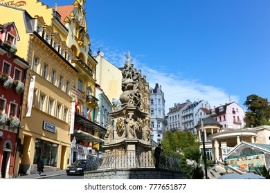 Karlovy Vary, Czechia - September 11, 2017: An example of Baroque architecture made of sandstone can be admired in the form of a sculpture, which is called the Holy Trinity Column.