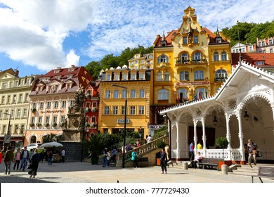 Karlovy Vary, Czechia - September 11, 2017: The colorful buildings and the white structure of the Market Colonnade in the old town of this fantastic resort is an example of magnificent architecture.